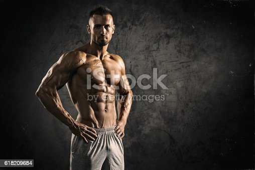 Portrait of a physically fit, muscular young man without a shirt.