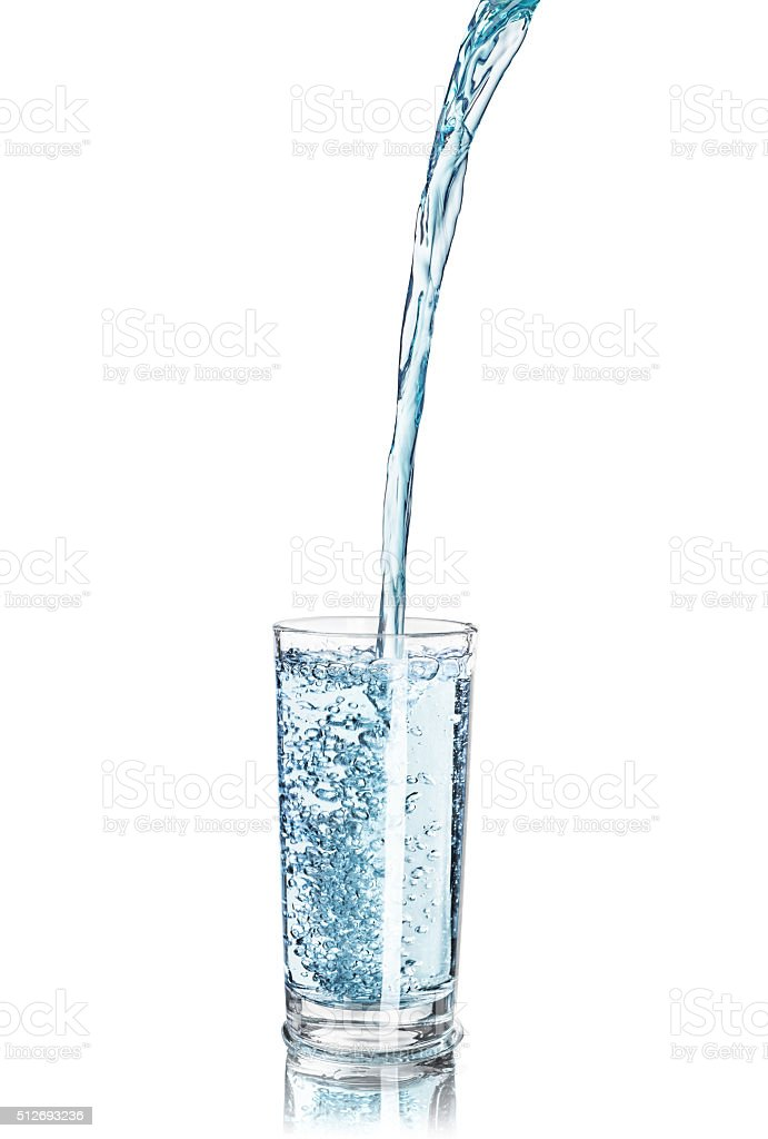 Strong pouring water pouring into a glass stock photo