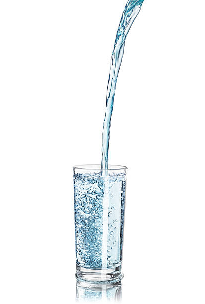 strong pouring water pouring into a glass - decant stock pictures, royalty-free photos & images