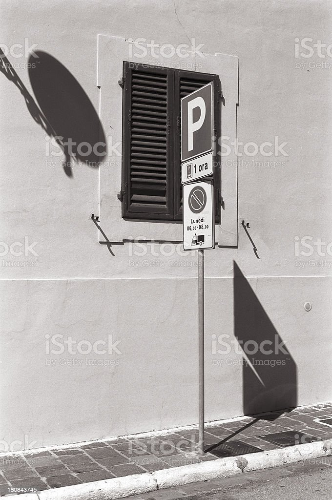 Strong shadow from a Car Parking sign, Italy royalty-free stock photo