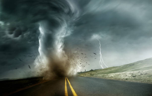 Strong Tornado Moving Through Landscape A powerful and dark storm producing a tornado crossing through fields and roads. Dramatic Landscape Mixed media illustration. extreme weather stock pictures, royalty-free photos & images