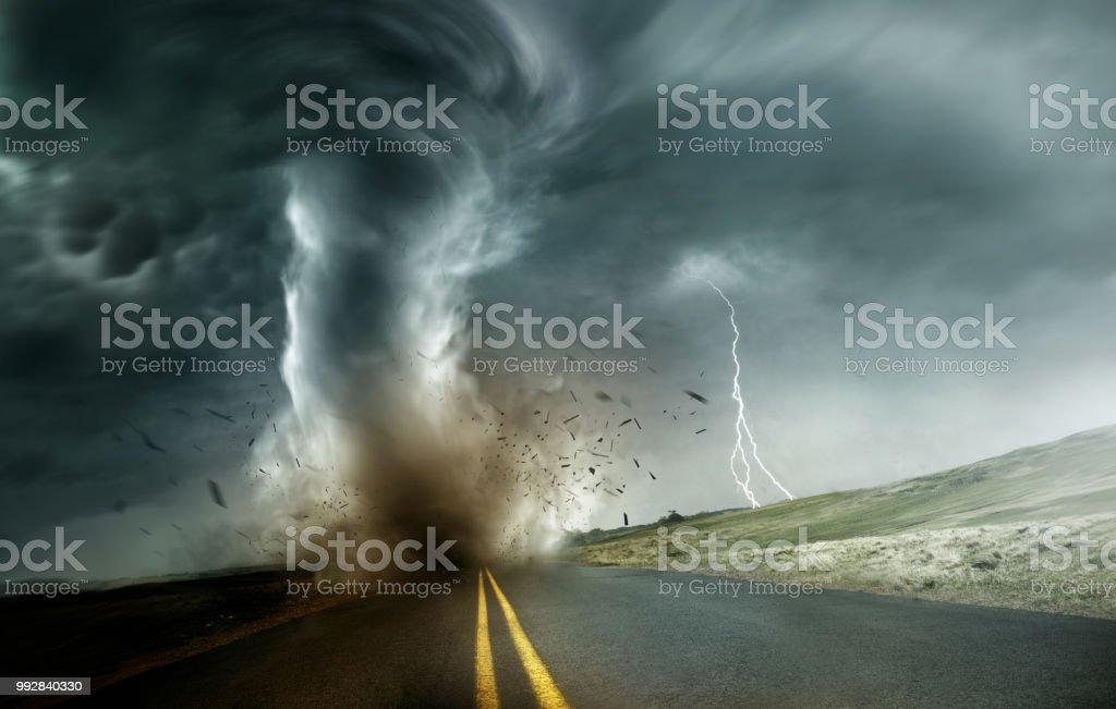 Strong Tornado Moving Through Landscape stock photo