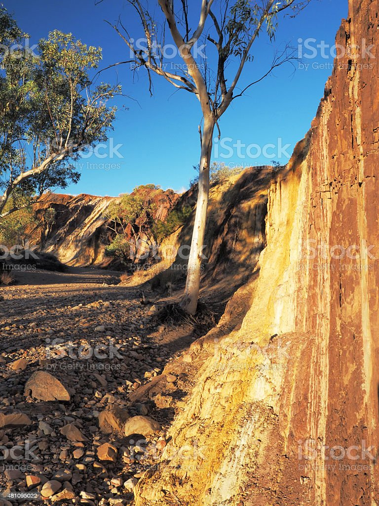 Strong upwards Ochre lines in the banks of a creek stock photo