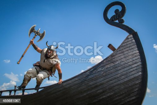 istock Strong Viking jumping from his ship to attack 455681067