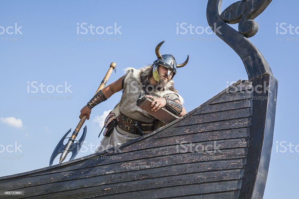 Strong Viking on his ship looking to beach stock photo