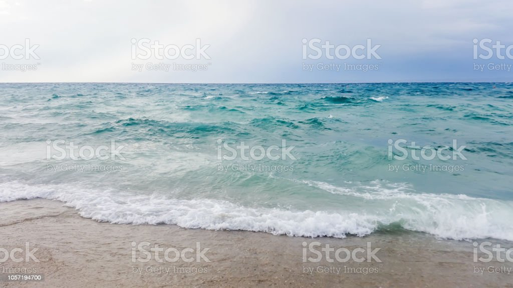 Strong waves crash over the beach Beautiful seascape. stock photo