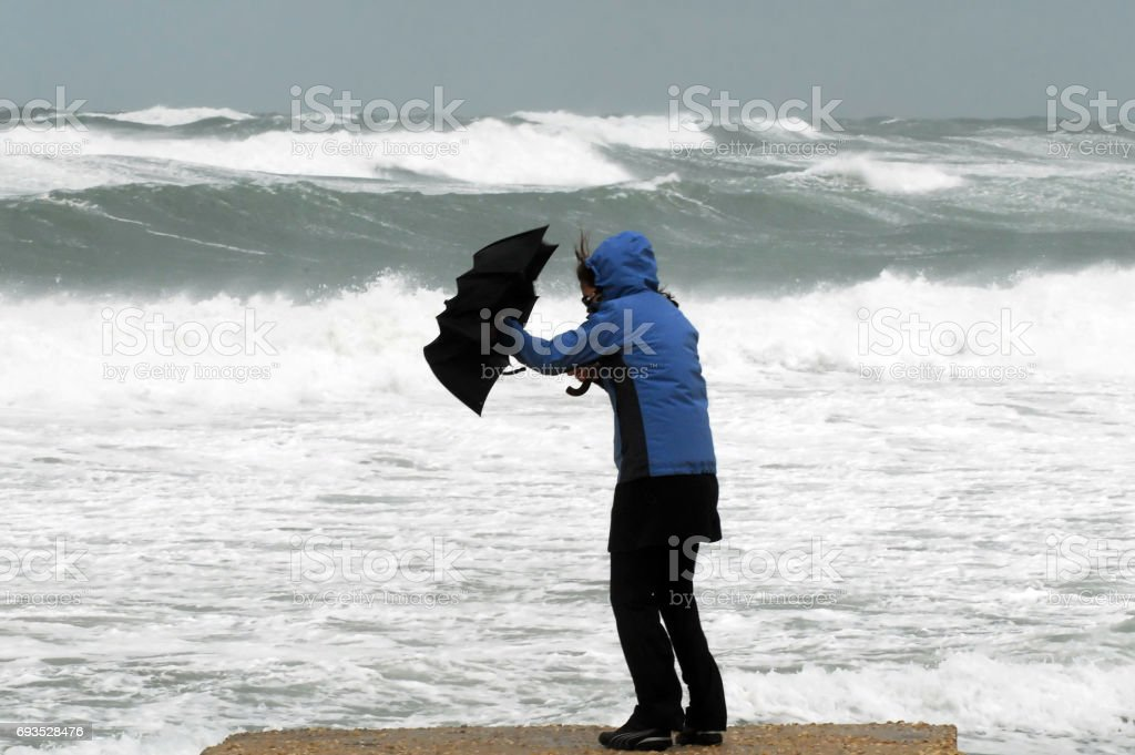 Strong Wind and Rain on Beach stock photo