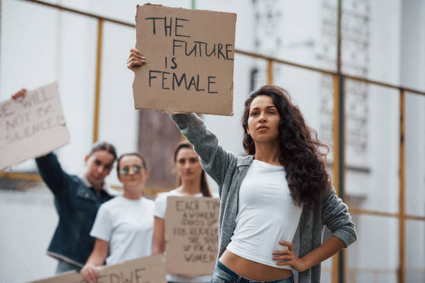 Strong woman. Group of feminist girls have protest for their rights outdoors stock photo
