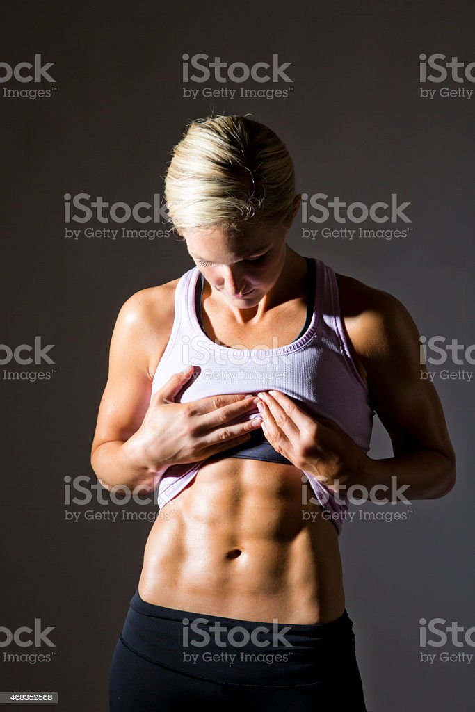 Strong Woman Showing Abs royalty-free stock photo
