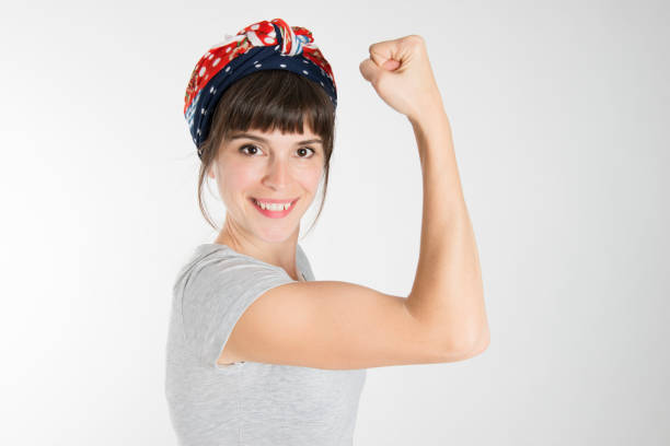 A strong woman showing her bicep stock photo