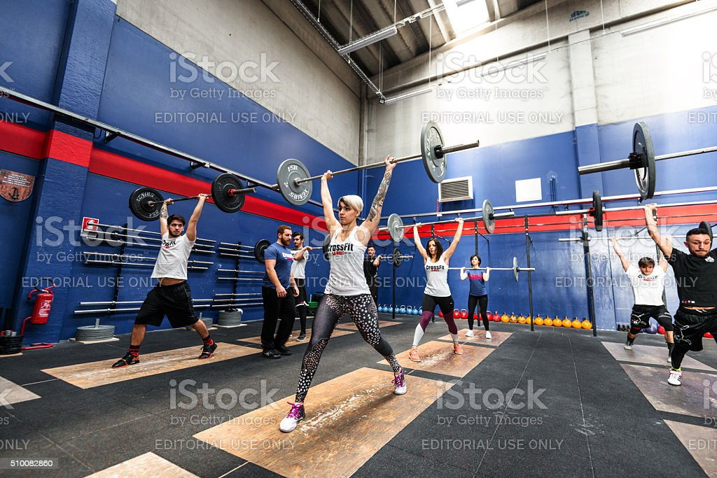 strong woman weightlifting on a gym big gym stock photo