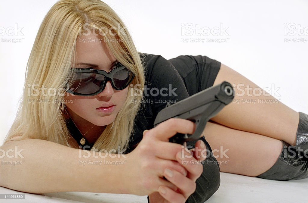 strong woman with black gun royalty-free stock photo