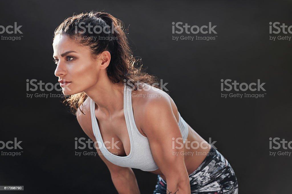 Strong woman with muscular body stock photo