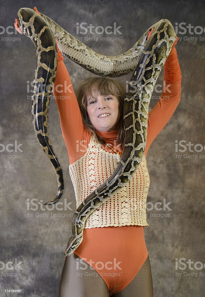 strong woman with Tiger Python stock photo