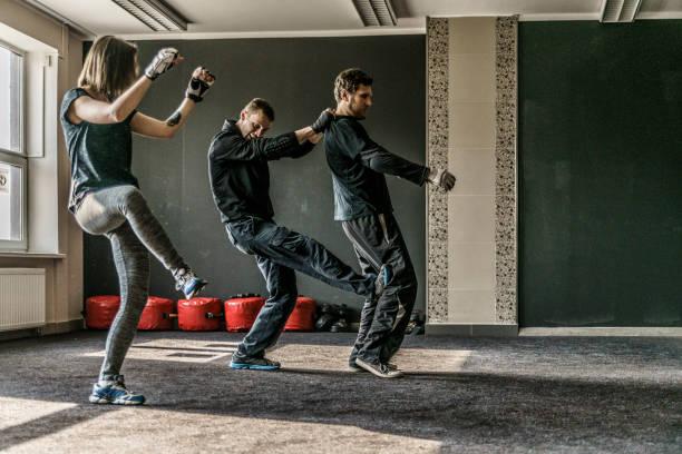 Strong women practicing self-defense martial art Krav Maga stock photo