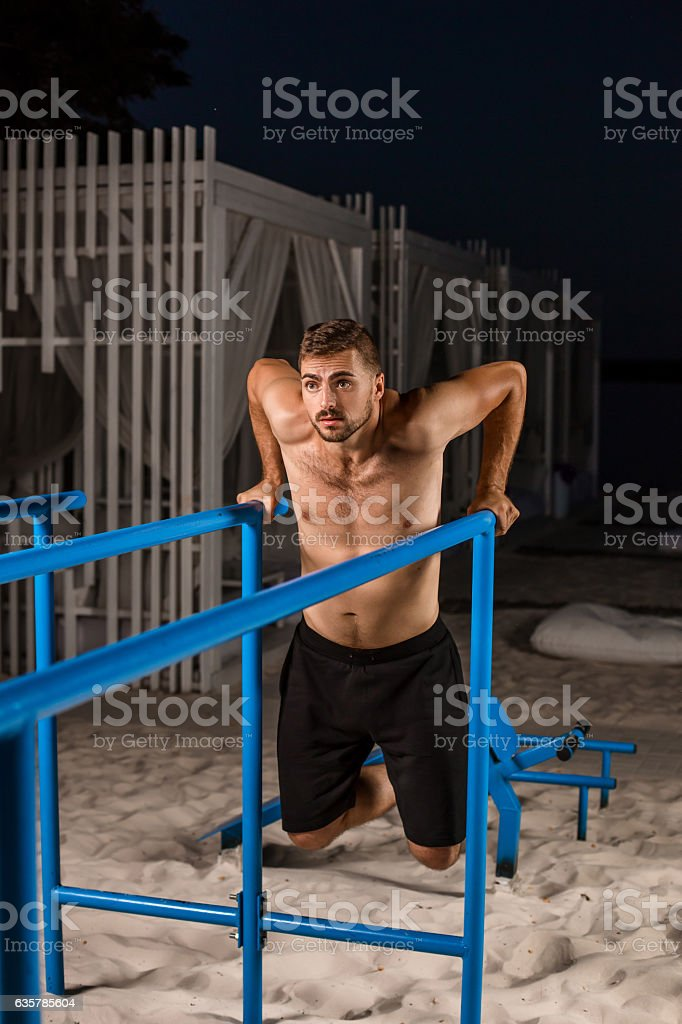 Strong young athlete is engaged in on sports field. stock photo