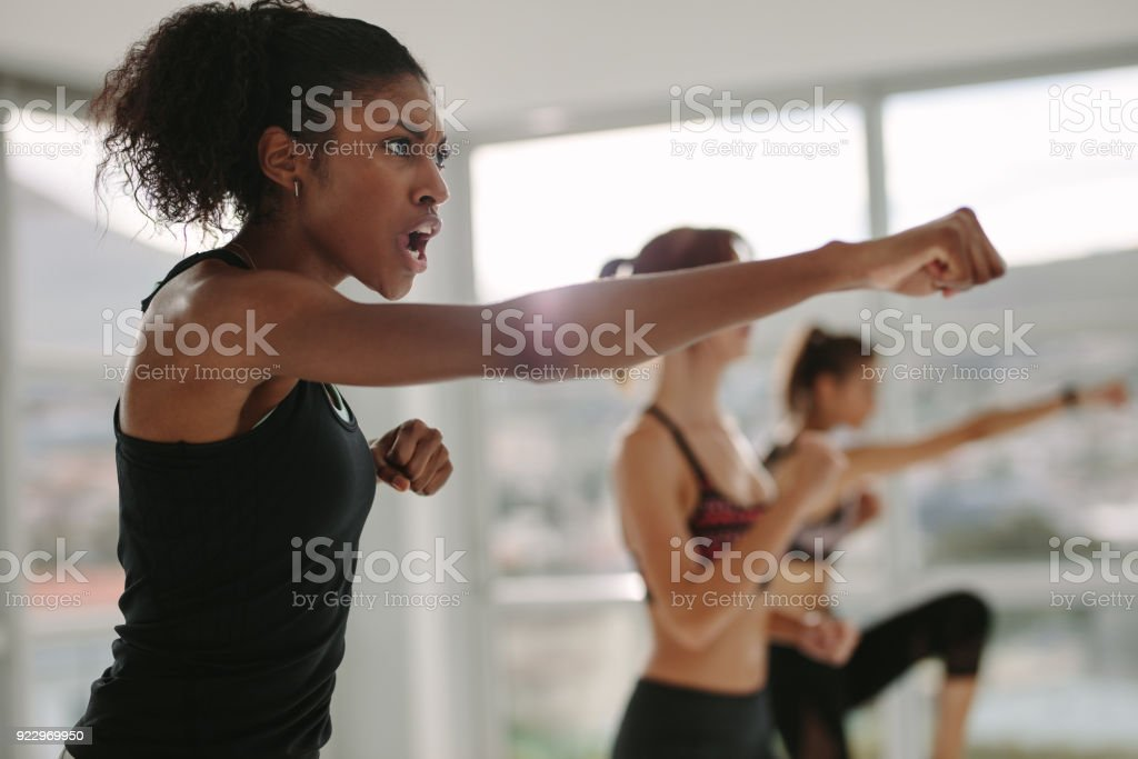 Strong young females exercising in gym stock photo