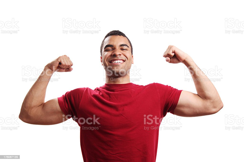 Strong young guy flexing his biceps stock photo