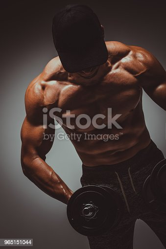 Strong Young Man Bodybuilder Performing Exercise For Biceps With Heavy Weights In Both Hands Concept Gym Life Styletoned Image - Stockowe zdjęcia i więcej obrazów Bez koszulki