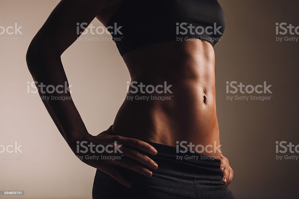 Strong young woman torso stock photo