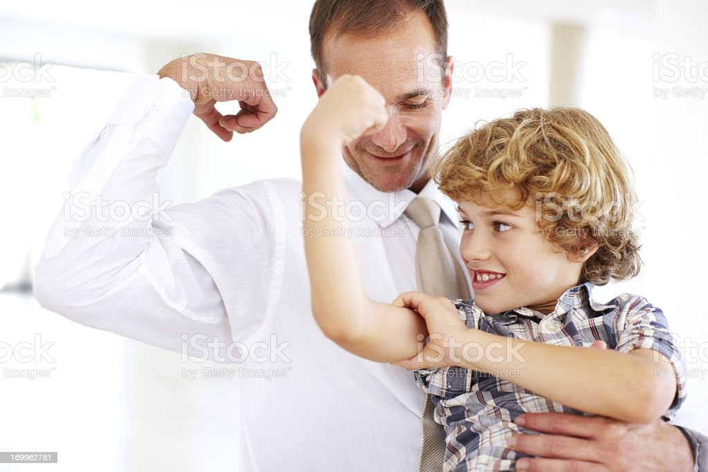 Stronger than Dad! royalty-free stock photo