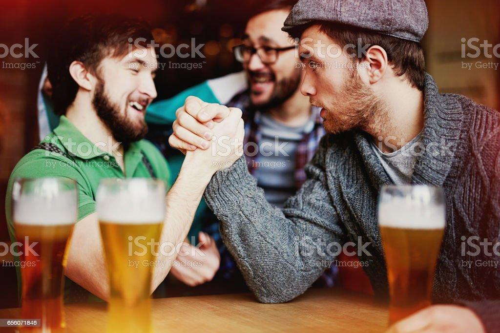 Strongman Contest in Irish Pub stock photo
