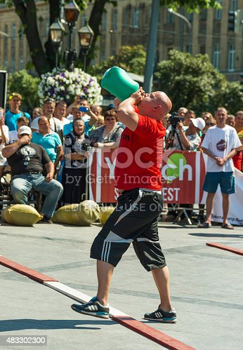 Strongman Inflates A Rubber Hot Water Bottle Stock Photo & More Pictures of  2015