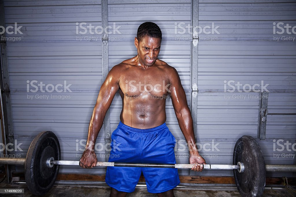 Strongman lifting barbell stock photo