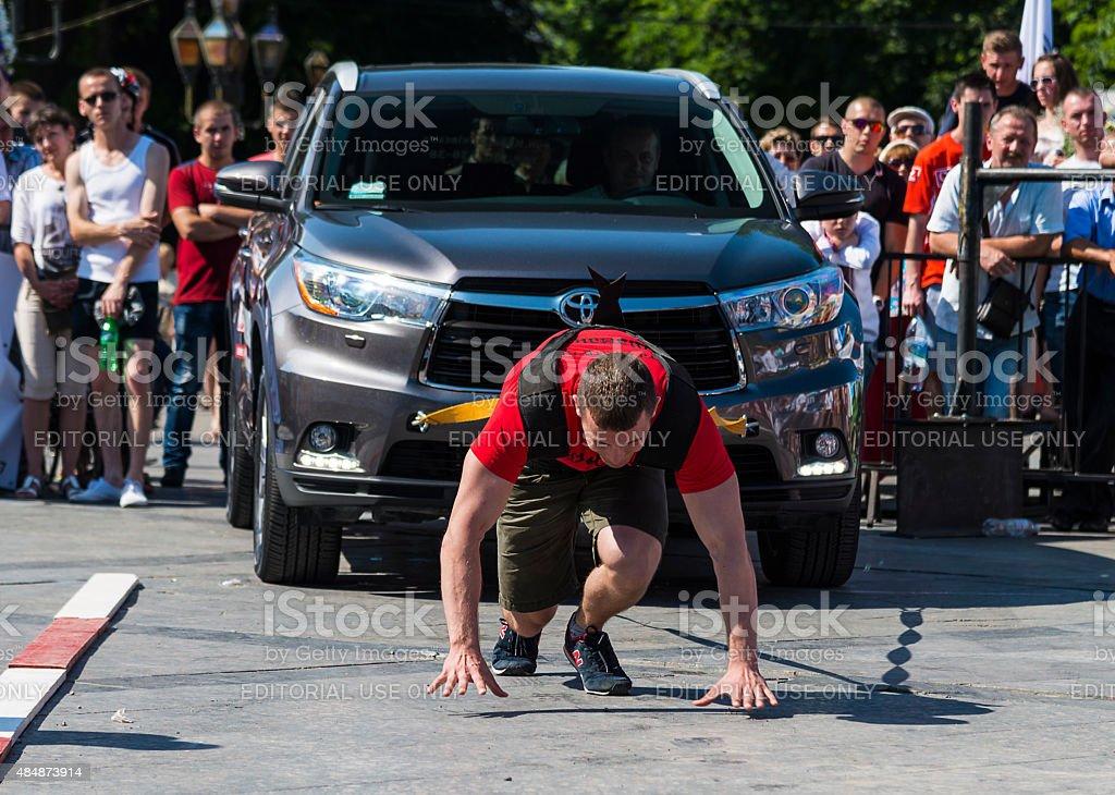 Strongman pulls Toyota Highlander stock photo