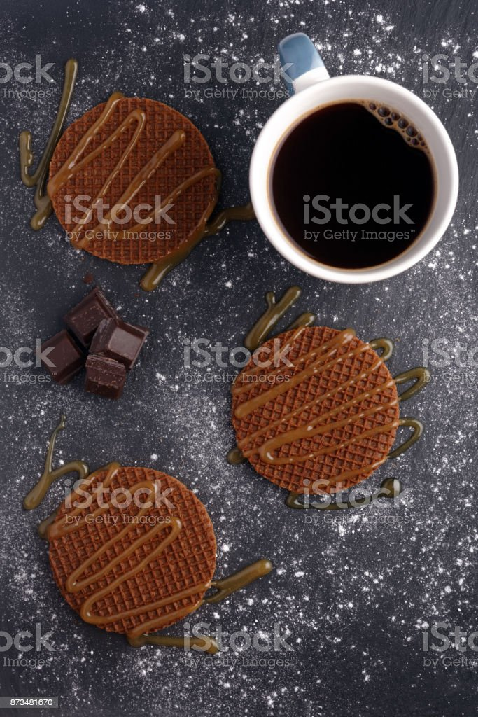 Stroopwafels with caramel sauce and coffee stock photo