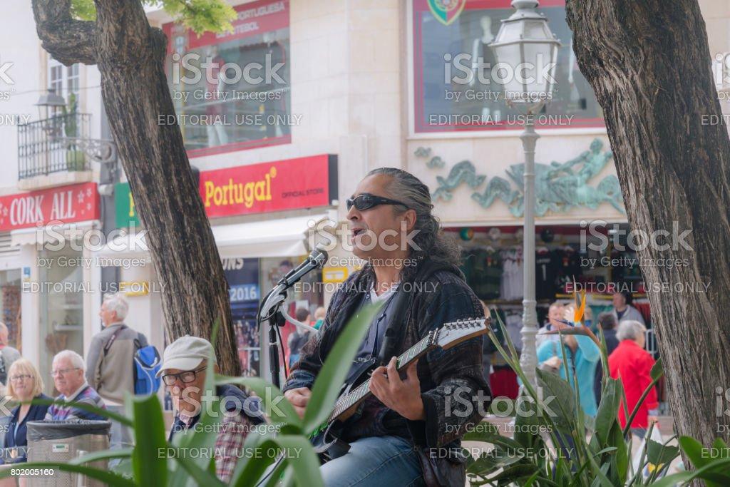 Strteet artist in Lagos, The Algarve, Portugal stock photo