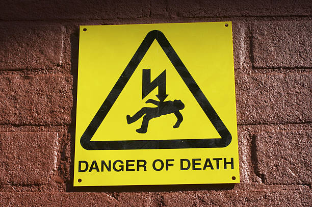 dramatic yellow notice danger of death - whiteway stock photos and pictures