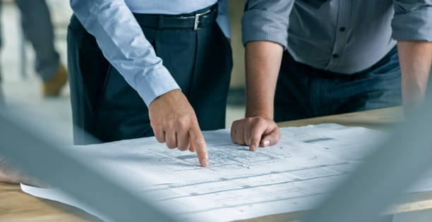 Structural engineer and architect discussing plans stock photo