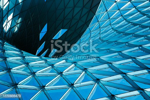 istock Structural glass facade of modern office building. Abstract architecture fragment. 1220935473