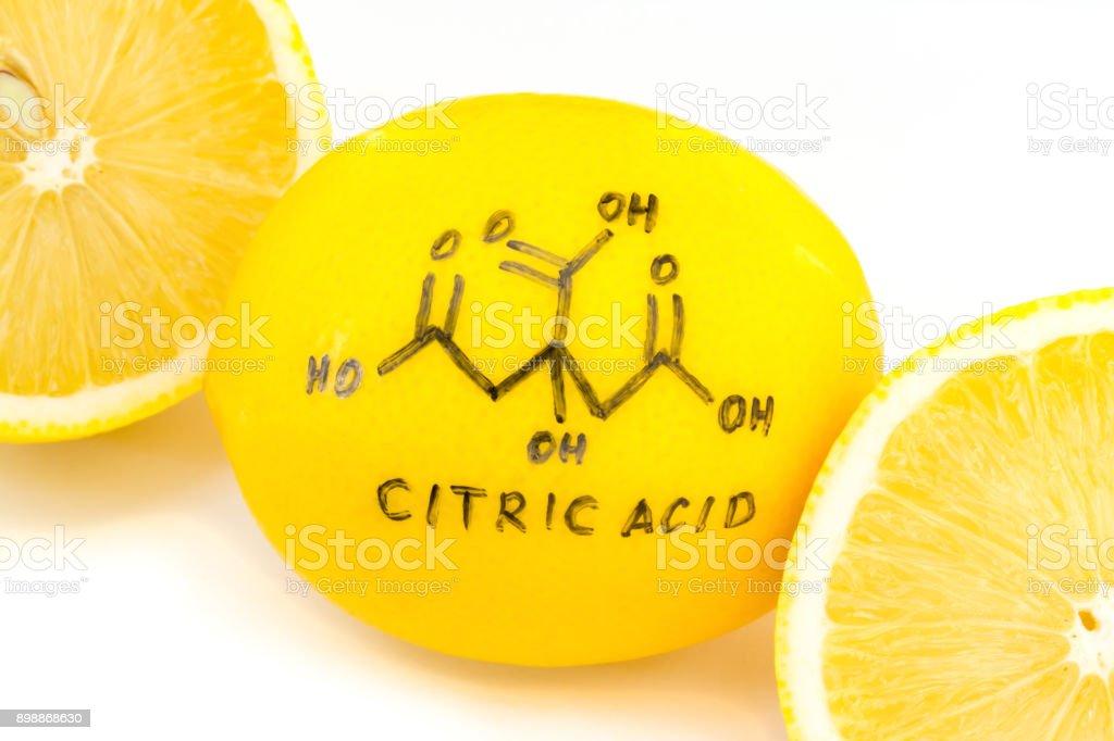 structure of a citric acid molecule painted on lemon peel stock photo