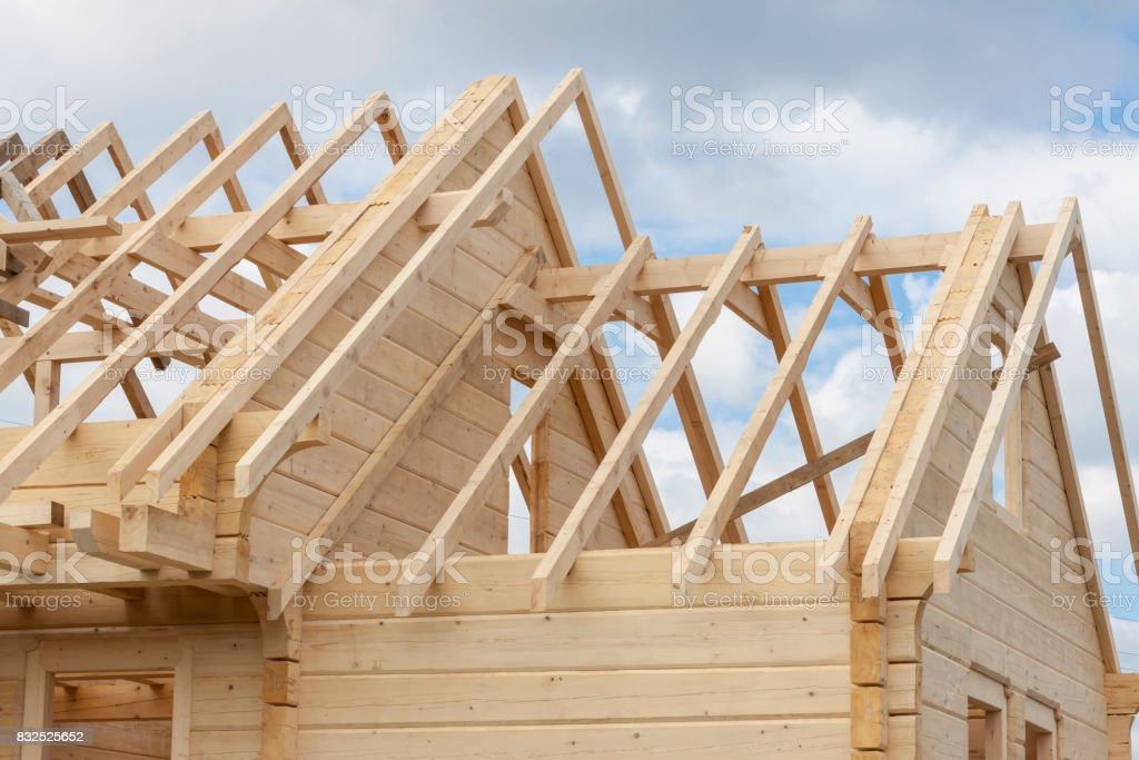 Structure of a wooden house under construction stock photo