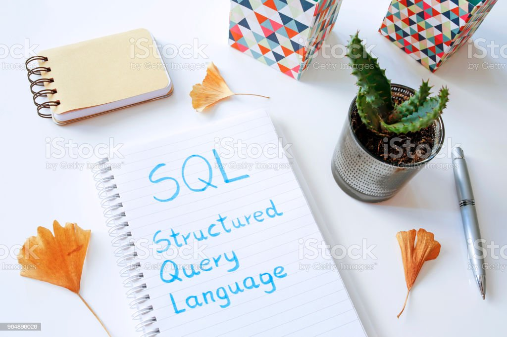 SQL Structured Query Language written in notebook royalty-free stock photo