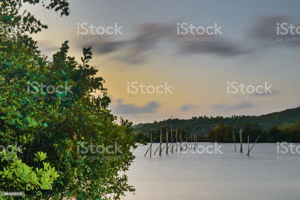 Structures constructed in a river for fishing stock photo