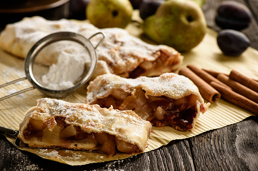 Strudel with pear, plums and cinnamon.