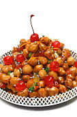 Struffoli, classic Italian Christmas candy with candied fruit and honey