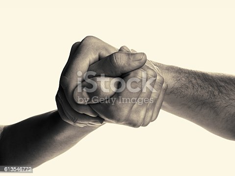 Struggle between the two rivals (arm wrestling). Image is black and white, toned, isolated.