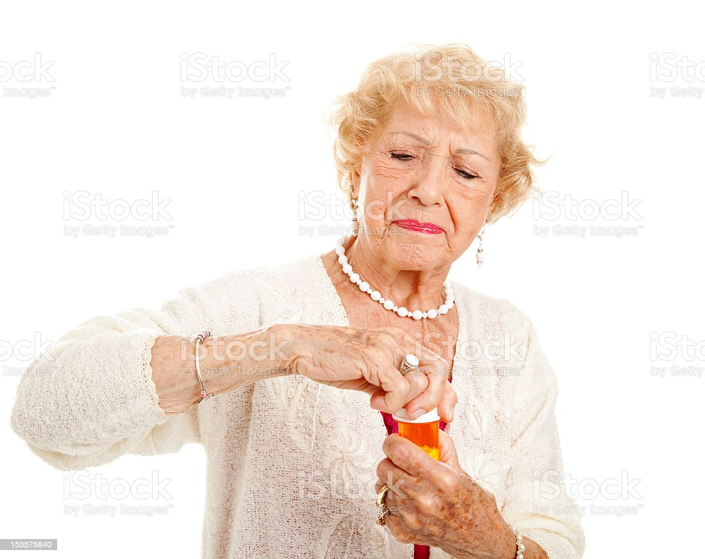 Struggling to Open Pills royalty-free stock photo