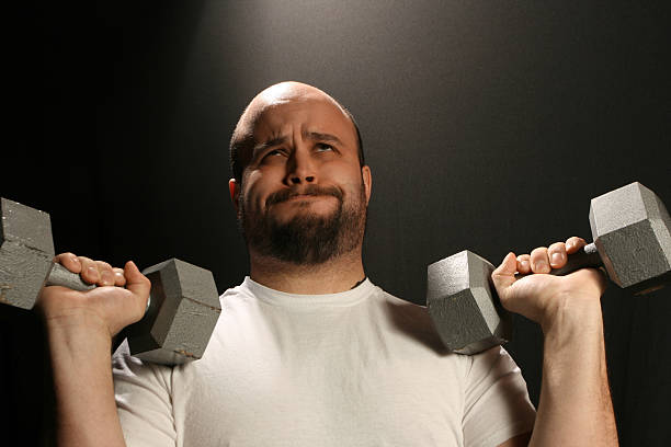 Struggling Weight Lifter stock photo