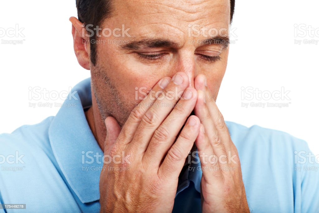 Struggling with his allergies stock photo