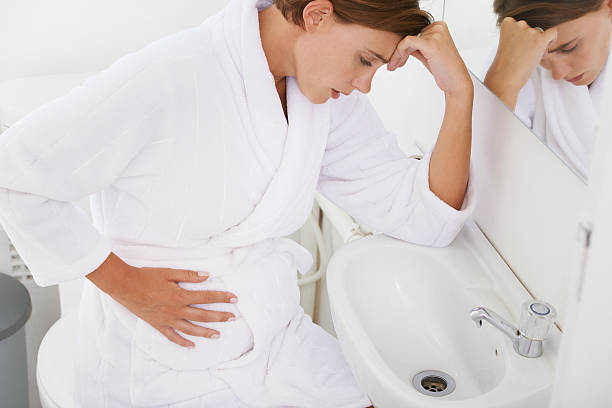 Struggling with morning sickness stock photo