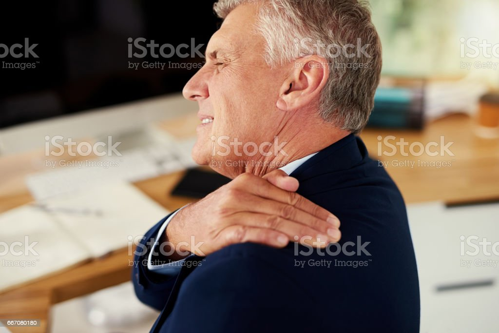 Struggling with unbearable shoulder pain stock photo