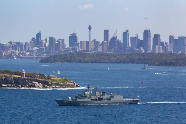 HMAS Stuart (FFH 153) Anzac-class frigate of the Royal Australian Navy departing Sydney Harbor. Sydney, Australia - October 11, 2013: HMAS Stuart (FFH 153) Anzac-class frigate of the Royal Australian Navy departing Sydney Harbor. naval base stock pictures, royalty-free photos & images