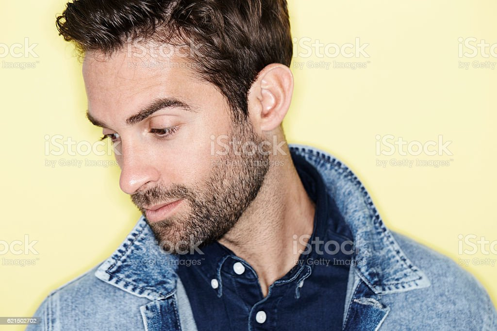 Stubble and denim man looking away foto stock royalty-free