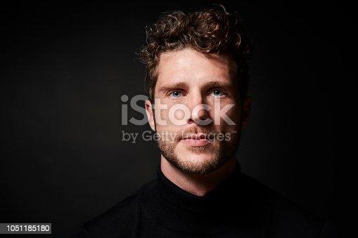Stubble guy in studio, portrait