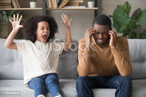 Stubborn noisy african child girl in tantrum screaming at annoyed tired black father, naughty kid daughter with attention deficit yelling, manipulation, family fight, parents and children conflict